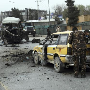Security personnel inspect the site of a bomb attack in Kabul, Afghanistan on Monday, March 15, 2021.