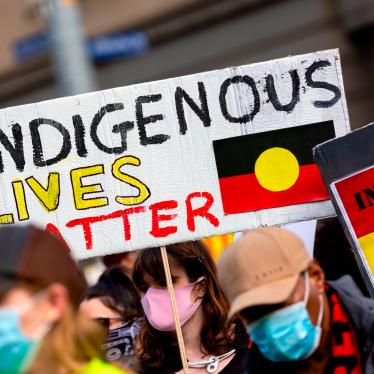 A woman holds an Indigenous Lives Matter placard during a Black Lives Matter rally on June 6, 2020 in Melbourne, Australia.