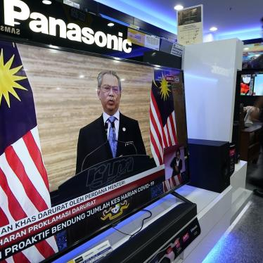 A television shows a live broadcast of Malaysian Prime Minister Muhyiddin Yassin at a shopping outlet in Kuala Lumpur, Malaysia, Tuesday, Jan. 12, 2021.