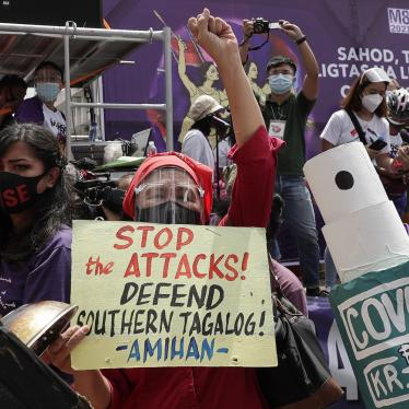 Protesters display slogans condemning the recent government attacks on activists during a rally near the Malacanang presidential palace on March 8, 2021 in Manila, Philippines.