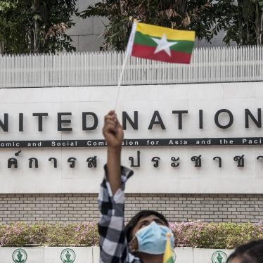 A protester waving a Myanmar nation flag in front of the United Nation building during the demonstration.
