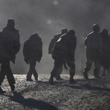 Ethnic Armenian soldiers walk along the road near the border between Nagorno-Karabakh and Armenia, Sunday, Nov. 8, 2020.