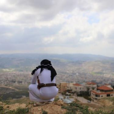 A Yemeni asylum seeker who arrived in Jordan in 2014, overlooks the city in the neighborhood of Abu Nseir, North of Amman, Jordan on March 25, 2021.