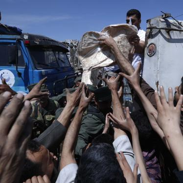 Syrian authorities distribute food to residents in the town of Douma, the site of a suspected chemical weapons attack, near Damascus, Syria, April 16, 2018.