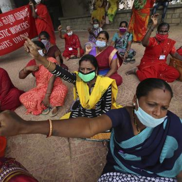 Women domestic workers, many of whom lost their jobs after the coronavirus outbreak, shout slogans at a protest demanding social security from the government in Bengaluru, India, June 15, 2020.