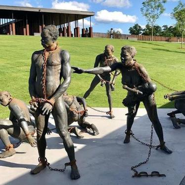 A sculpture of African slaves by Ghanaian artist, Kwame Akoto-Bamfo, at the beginning of the National Memorial for Peace and Justice in Montgomery, Alabama.