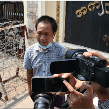 P journalist Thein Zaw talks to reporters outside Insein prison after his release Wednesday, March 24, 2021 in Yangon, Myanmar.