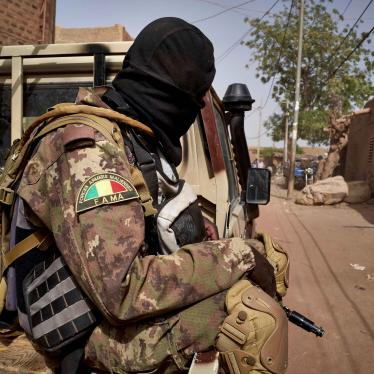 A member of the Malian Armed Forces (FAMA) patrols a road in central Mali, February 2020.