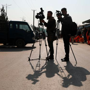Afghan journalists film at the site of a bombing attack in Kabul, Afghanistan, Tuesday, Feb. 9, 2021.