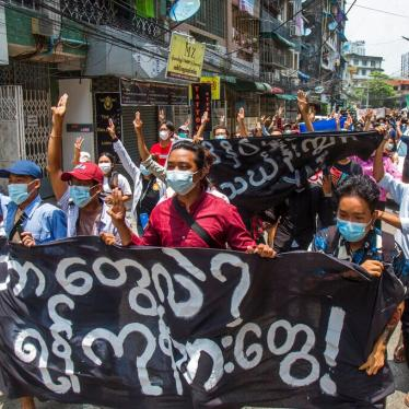 "Anti-coup protesters hold a banner that reads ""What are these? We are Yangon residents!"" as they march during a demonstration in Yangon, Myanmar on Tuesday April 27, 2021."