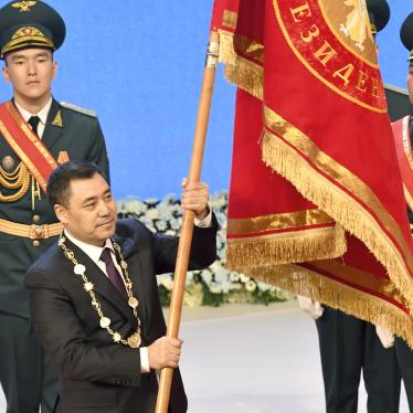 Kyrgyzstan President Sadyr Zhaparov holds presidential standard during his inauguration ceremony in Bishkek, Kyrgyzstan.