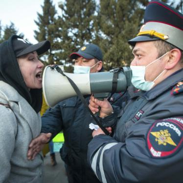 A woman argues with a police officer during a protest in support of jailed opposition leader Alexei Navalny in Ulan-Ude, Russia, April 21, 2021.