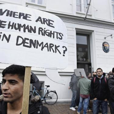 Syrian refugees hold banners outside the Swedish Embassy in Copenhagen, Denmark, protesting Denmark's asylum policies towards those who fled Syria's civil war, September 26, 2012.