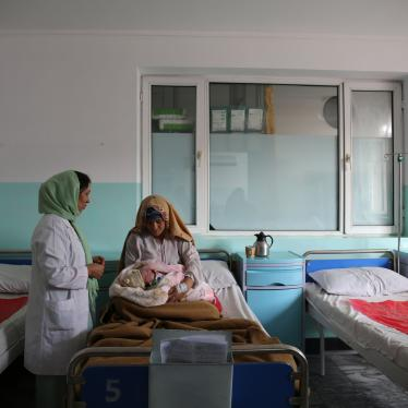 A new mother holds her hour-old baby in the maternity ward at Dasht-e-Barchi hospital in Kabul, Afghanistan, October 2020. She had travelled from neighboring Laghman province to give birth at the hospital. On May 12, 2020, unidentified gunmen attacked the hospital's maternity ward, killing 24 people, including 16 mothers, 2 children, and a midwife. Three new mothers were killed in the delivery room. Another 20 people, including babies, were injured in the four-hour attack. Ongoing security concerns have lef