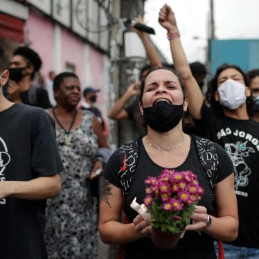 Activists and relatives of victims shout slogans and demand justice the day after a deadly police operation in the Jacarezinho favela of Rio de Janeiro, Brazil, May 7, 2021.