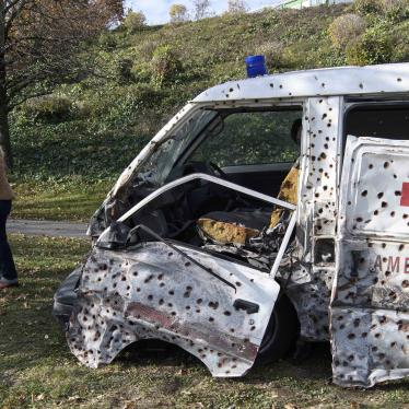 An ambulance covered in bullet holes