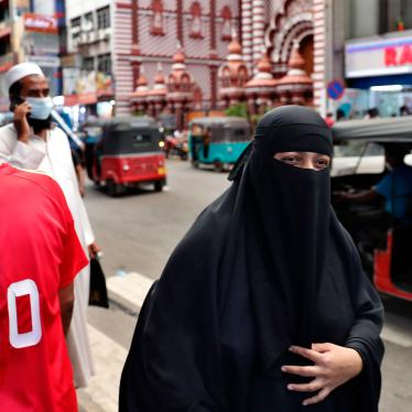 A Sri Lankan Muslim woman wearing a burka walks in a street in Colombo, Sri Lanka