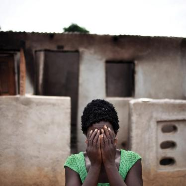A woman hides her face after recounting how pro-Ouattara forces killed two of her children and her brother during the post-election violence in Duékoué, western Côte d'Ivoire.
