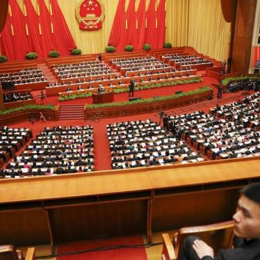 China: New Law Escalates Repression of Groups