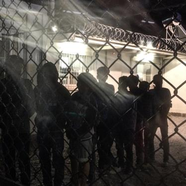 Unaccompanied children line up for an evening meal at a detention facility run by the Greek police.