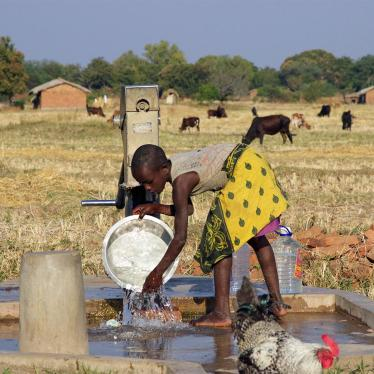 Young girl washing dishes at a borehole near Eland coal mine in Mwabulambo, Karonga district.