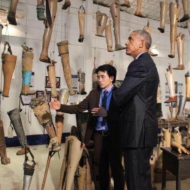 During President Obama's historic visit to Laos, he met with cluster bomb victims and toured the Cooperative Orthotic and Prosthetic Enterprise (COPE) visitors' centre in Vientiane with its operations manager Soksai Sengvongkham.