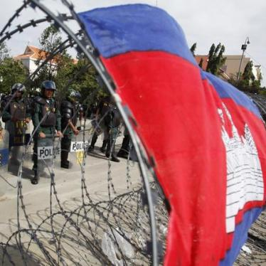 Cambodia: Quash Case Against 11 Opposition Activists
