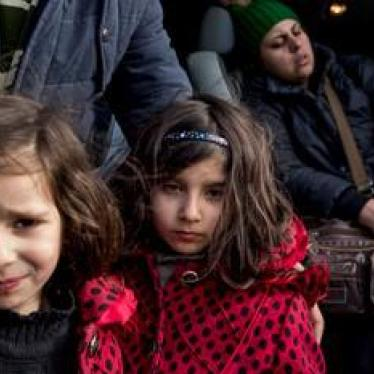 Two young Iranian sisters at the Idomeni border crossing between Greece and Macedonia. The border crossing is closed to all except those from Syria, Iraq, and Afghanistan who intend to seek asylum in Germany or Austria, stranding other asylum seekers and