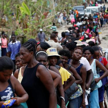 People make a line as they wait for food to be handed out after Hurricane Matthew hit Jeremie, Haiti, October 19, 2016.