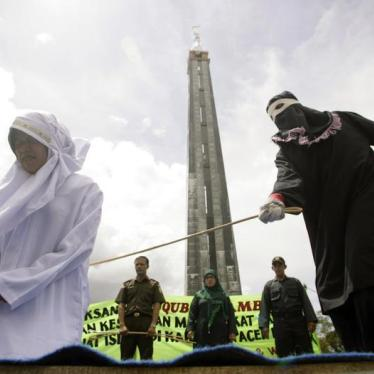 Indonesia's Aceh Authorities Lash Hundreds Under Sharia Statutes