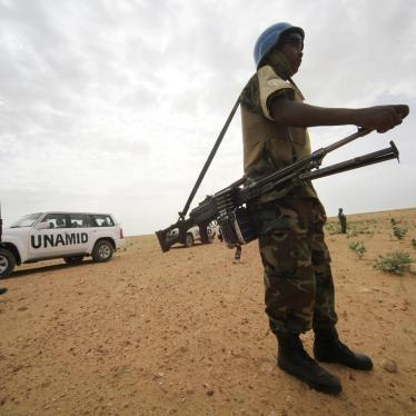 United Nations Mission in Darfur peacekeepers stand guard in Shagra village, North Darfur, October 18, 2012. © 2012 Reuters