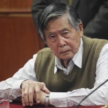 Peru's former President Alberto Fujimori listens to the judge's verdict about his sentence in prison, in Lima October 29, 2013.