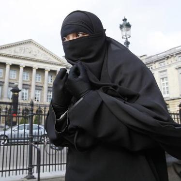 Salma, a 22-year-old French national living in Belgium who chooses to wear the niqab after converting to Islam, gives an interview to Reuters television outside the Belgian Parliament in Brussels in this April 26, 2010 file photo.