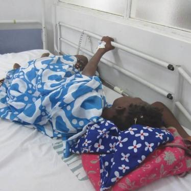 During a morphine shortage, a cancer patient in Dakar cluthes onto the railing of her hospital bed because she is in pain and the medication she needs is unavailable.