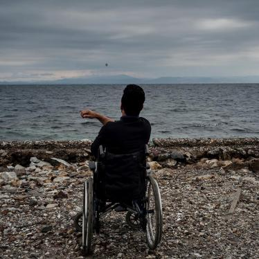 Ali, a 22-year-old Afghan asylum seeker with a disability, living in Moria camp, on the beach in Lesbos, Greece. He told Human Rights Watch he can't access showers in the camp and sometimes tries to wash himself in the sea.