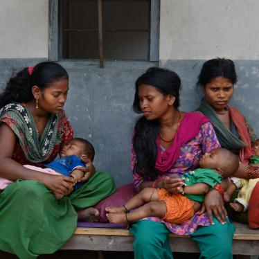 Women and girls wait with their children outside a doctor's office in Chitwan, Nepal.