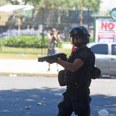 A member of Argentine National Gendarmerie aims his gun to demonstrators during a protest.