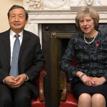 UK's May Needs to Get Tough with China on Rights