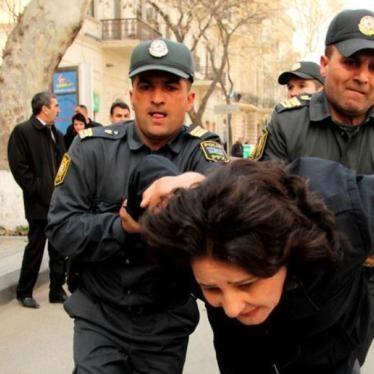 Azerbaijan Courts Convict Two Outspoken Government Critics