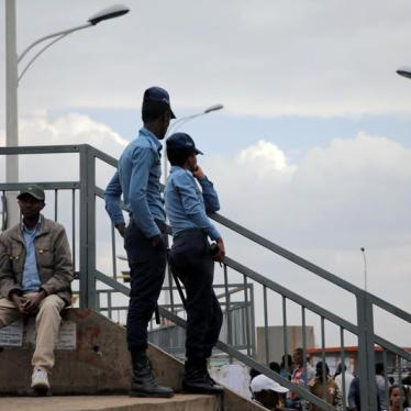 Ethiopia's police officers watch over a foot bridge as they patrol the streets of Addis Ababa, Ethiopia February 21, 2018.