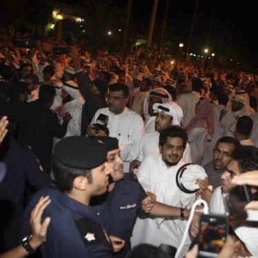 Kuwaitis protest outside the parliament building in Kuwait City November 16, 2011.