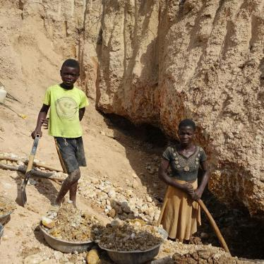 A boy and a girl work in a small gold mine in Amansie West district, Ghana.