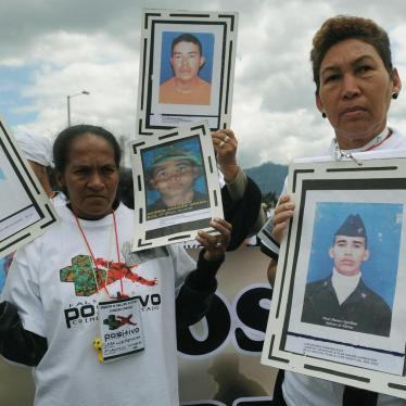 "Relatives hold pictures of their beloved during a March 6, 2009 march in Bogota against the ""false positive"" killings and enforced disappearances."