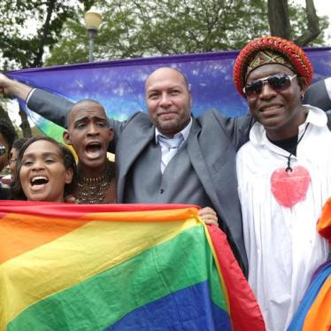 Jason Jones, activist of the LGBT community celebrates with other activist court judgment outside the Hall of Justice in Port-of-Spain, Trinidad and Tobago, April 12, 2018.