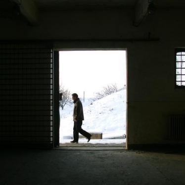 A Romanian journalist walks past a building on the Mihail Kogalniceanu Airbase, 250km (155 miles) east of Bucharest, cited as a possible location for the transfer of terrorist suspects by the CIA. December 19, 2005.