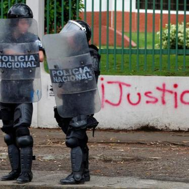 "Riot police officers stand in front of a graffiti that reads ""Justice"" during a protest against Nicaragua's President Daniel Ortega's government in Managua, Nicaragua May 28, 2018."