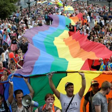 Participants hold a giant rainbow flag during the Prague Pride Parade where thousands marched through the city centre in support of gay rights, in Czech Republic, August 13, 2016.