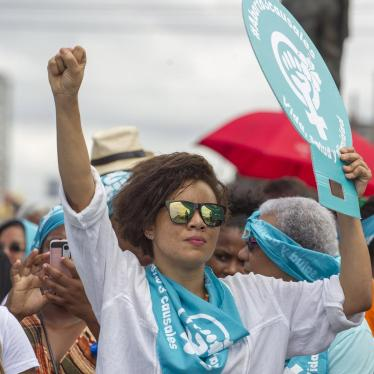 People take part in a march in Santo Domingo for the decriminalization of abortion in three circumstances: when the life of a pregnant woman is in danger, when the pregnancy resulted from rape, or when the fetus will not survive outside the womb.