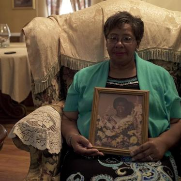 Ms. Frances Ford, executive director of Sowing Seeds of Hope, in her home in August 2018, holding a picture of her mother, who died from cervical cancer after being diagnosed in 1980.