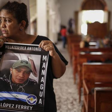 Martha Lorena Alvarado, mother of jailed anti-government demonstrator Melkissedex Antonio Lopez, holds a sign with an image of her son while participating in the hunger strike at the San Miguel Arcangel Church in Masaya, Nicaragua, on Thursday, November 1